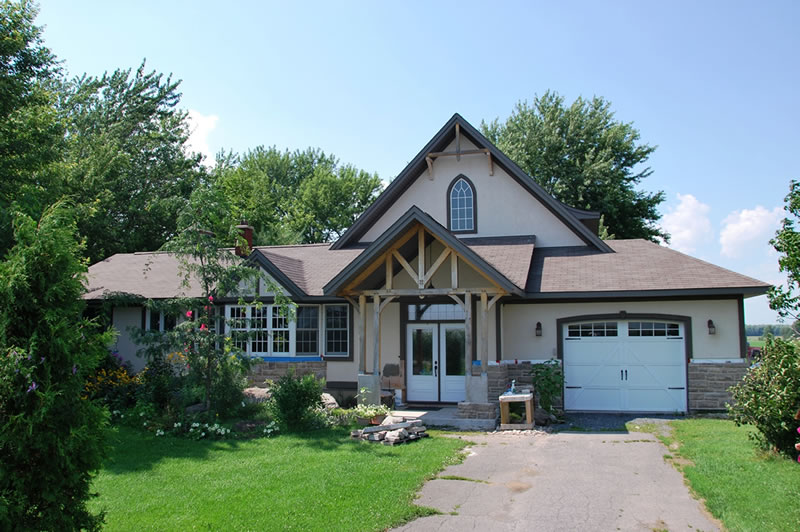Renovation to ranch-style bungalow including oak timber frame living room/master suite addition and porches, Iroquois ON.
